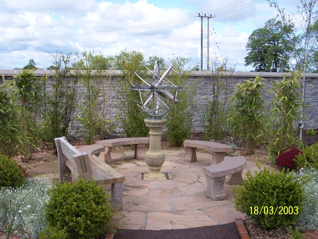garden patio with central feature Lisburn